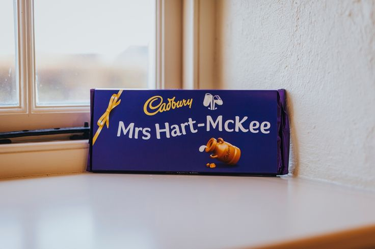 A huge personalised Cadbury's Dairy Milk bar for the bride! Photo by Benjamin Stuart Photography #weddingphotography #cadburys #dairymilk #bridegift #weddinggift #chocolate