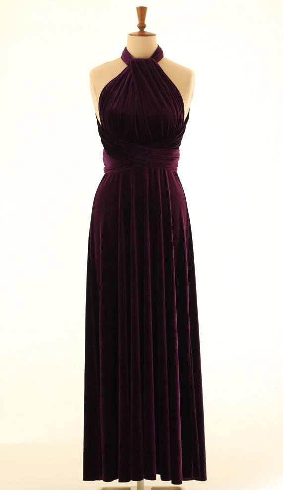 Beautiful infinity dress made in a rich purple velvet.  This versatile infinity dress can be worn in more than fifteen different ways by varying the wrapping of the two front vertical bands, with a number of options shown in the photos. It can thus be conservative or daring, and brings glamour to a variety of formal occasions such as balls, proms and dinners, as well as being a popular choice for bridesmaids. It is made with a soft stretch velvet which looks and feels very luxurious.  The…