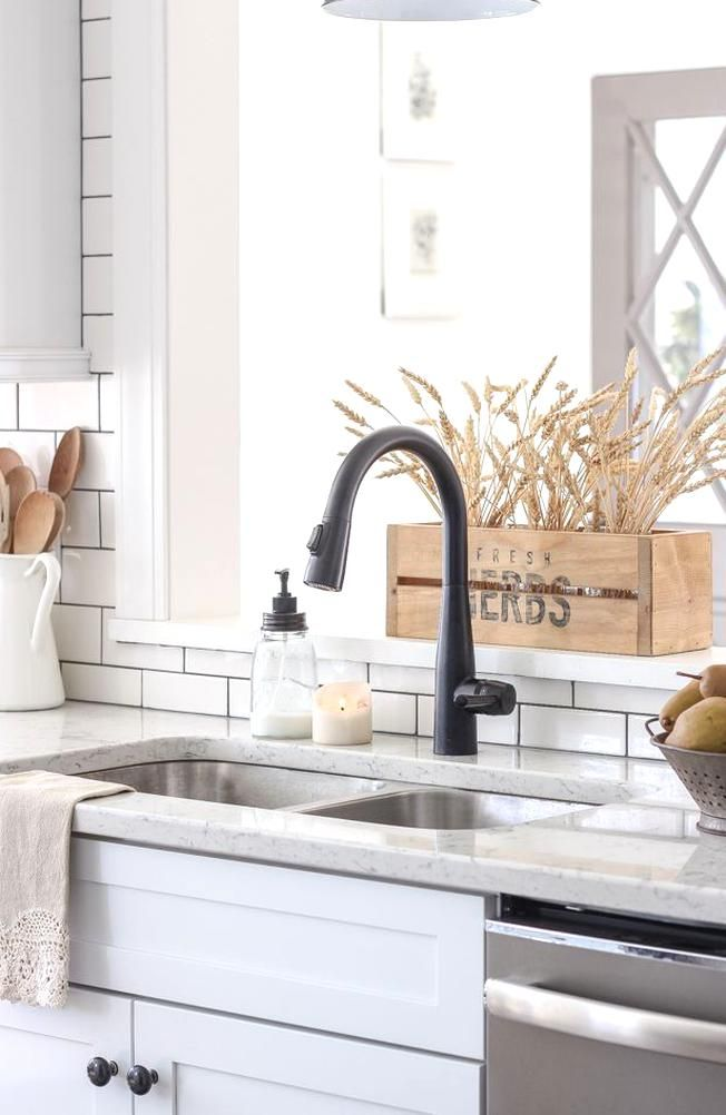 A Beautiful Farmhouse Kitchen Decorated With Simple Cozy Touches Of Fall Kitchen Decor Kitchen Decor Apartment Kitchen Remodel