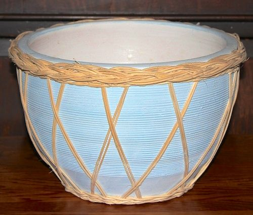 """Planter - Blue w/wicker - This round planter measures 9 1/4"""" across the top and 5 1/4"""" across the bottom...glazed on the inside...has a wicker base and trim...Order # P-2350... $9.95"""