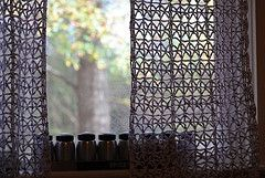 crochet curtains.  Might also be a lovely shower curtain.