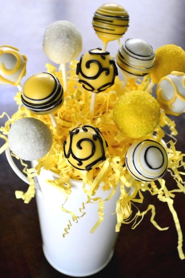 Yellow cake pops Www.facebook.com/cakepoppin