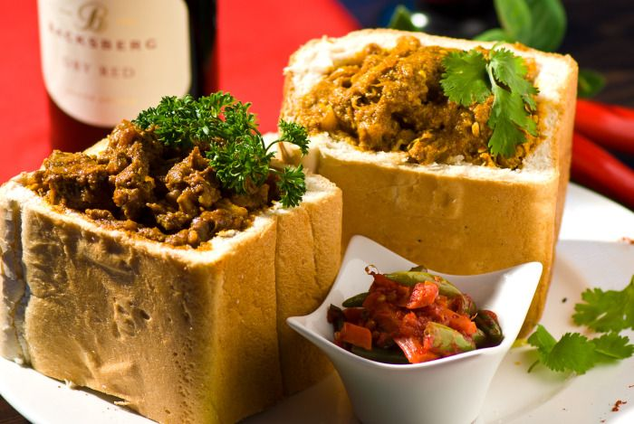Bunny Chow - Durban, the thriving, seaside heart of South Africa, is best known for three things: its sprawling, golden sand beaches; its bustling, humming port; and bunny chow, deliciously savory, slow-cooked lamb curry served inside a hollowed-out loaf of bread. I may be overstating things—but not by much. Humble though it may seem, bunny chow is actually …