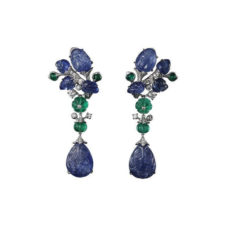 Platinum, two pear-shaped carved sapphires totaling 25.24 carats, melon-cut emerald beads, cabochon-cut emeralds, sapphire carved leaves, brilliants.