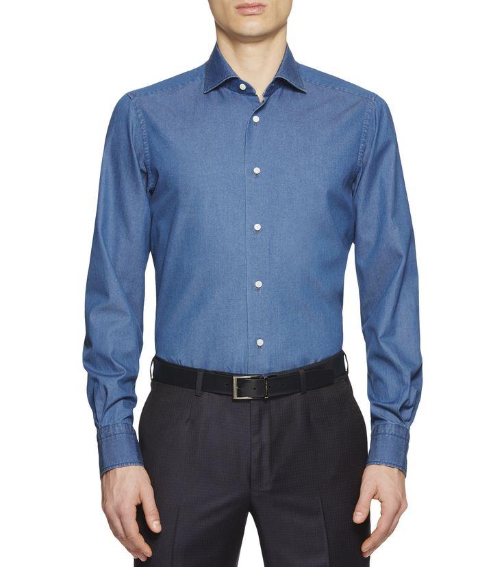 ERMENEGILDO ZEGNAРУБАШКИ:         Блеск хлопка Denim прекрасно подчеркивает строгий стиль этой рубагки    <br>• Светло-синяя рубашка из хлопка Denim <br>• С длинным рукавом