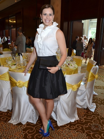 Style File pick of the week: Courtney Kurylo in a white ruffled blouse from Elie Tahari, a black, pleated skirt by Kate Spade & colorful Jessica Simpson pumps at the Latin Women's Initiative 10th anniversary luncheon.