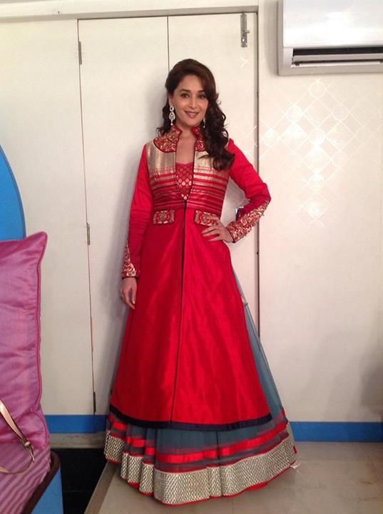 Madhuri Dixit wearing a grey lehenga with red bandhgala jacket promoting her upcoming film. Grab the same at: http://www.shadesandyou.com/product-category/readymade-suits/  #AnarkaliSuitsOnline #PartyWearSalwarKameez #PakistaniSuits #SalwarKameez