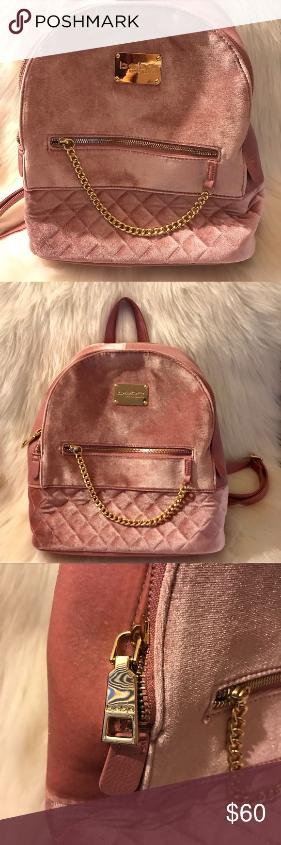 "Bebe Backpack Gina Large Velvet Large Blush Pink Retails for $109! Upgrade your backpack with this unique and stylish one. This backpack features super soft velvet fabric. Golden logo plate and zippers add an extra layer of shine to this piece. Has adjustable shoulder straps. Makes the perfect gift this holiday season. Bundle to save!  11.5"" L X 12.5"" H X 4.5"" D Top carry handle Adjustable shoulder straps Interior: 2 slip pockets, 1 zipper pocket Exterior: 2 slip pockets, 1 zipper pocket Top…"