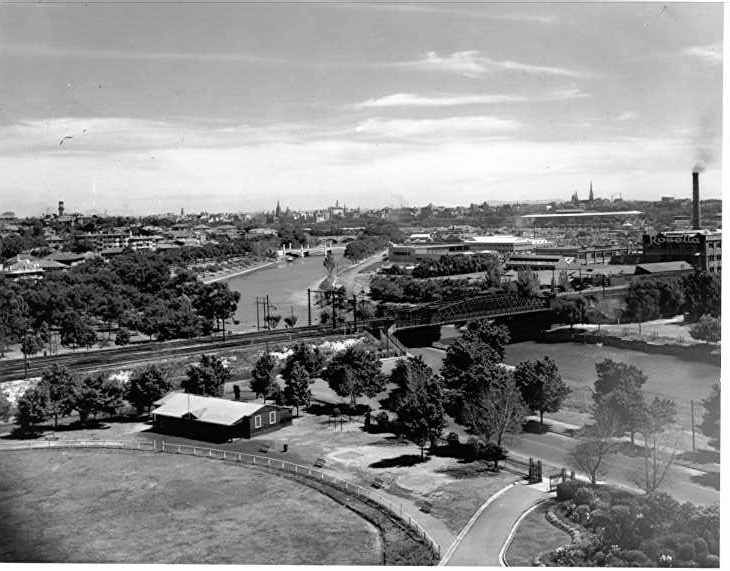 PH 8779. The view looking north west from the vicinity of Melbourne High School, across the old railway bridge towards the city. This bridge was replaced in the mid-1940s.