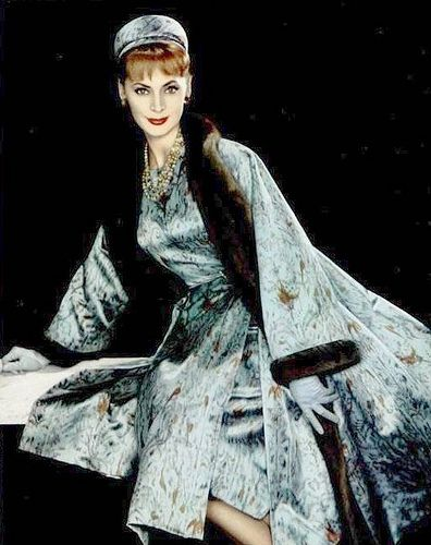 Ghislaine Arsac is wearing Jean Patou's luxurious ensemble of printed silk trimmed in mink, 1957 Photo by Philippe Pottier