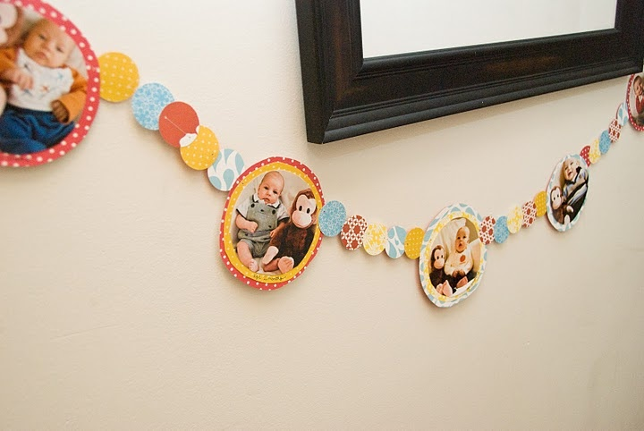 Have photos of A hang from the previously pinned decorations (vertical circles taped to string)