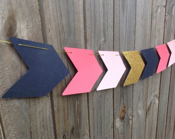 *** I kindly ask you to carefully read item description and shop policies before ordering *** *** Handmade in Australia *** This listing is a for an ARROW garland with movable arrows. At the drop down menu, you may select a banner with 12 or 16 arrows Colours: navy blue, pink, light pink & gold glitter Material: 200gsm cardstock Size: 9.5cm tall x 12cm wide. Gold string is included separately in each package. Easy assembly is required. Would you like different size or colour? Please s...