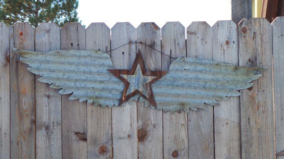 Hummm some rustic for my Rustic/ Luxe design.  Upcycled old Corrugated Metal Wings with Star by RockinBTradingCo, $39.00