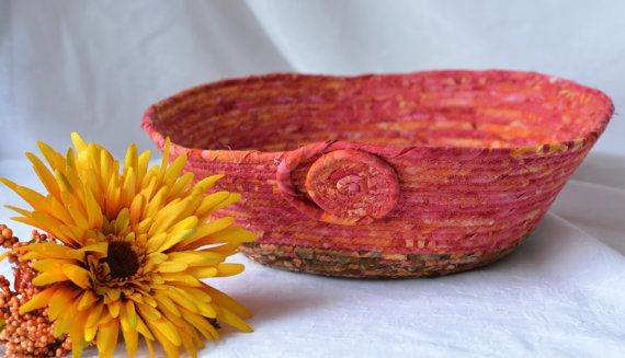 Lovely Southwestern Basket , I just love this pretty pinky batik fabric and made this lovely basket for your table.  $25 Handmade Fiber Bowl by me of  Wexford Treasures