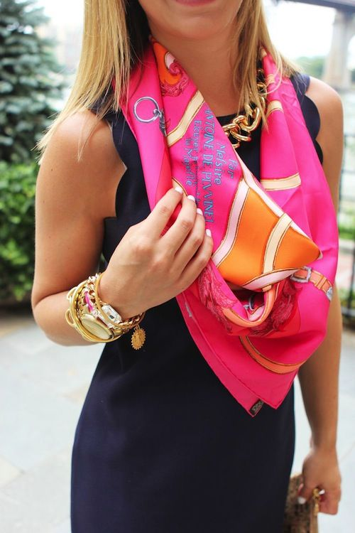 navy shift dress, bold scarf, chunky gold jewelry.