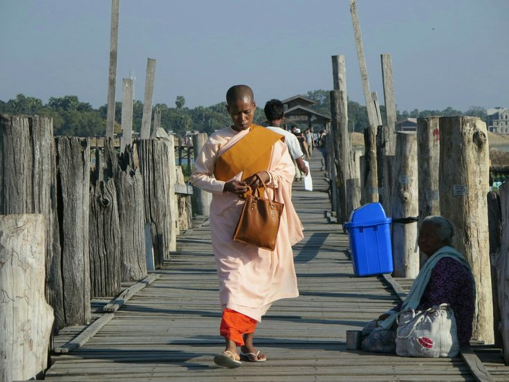 Nun on U- Bein- Bridge, Amarapura, Myanmar