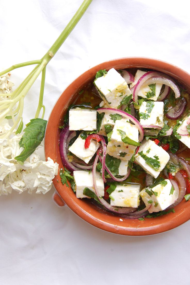 Marinated feta with red onion, olive oil, coriander, lemon zest, garlic and chilli. The best!