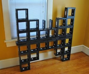 how cool would it be to have DVD shelves made of VHS tapes?