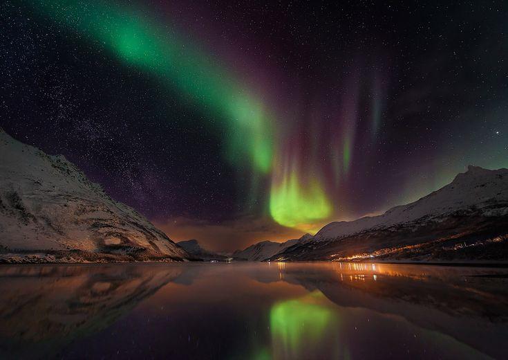 Звезды и северное сияние в Норвегии.