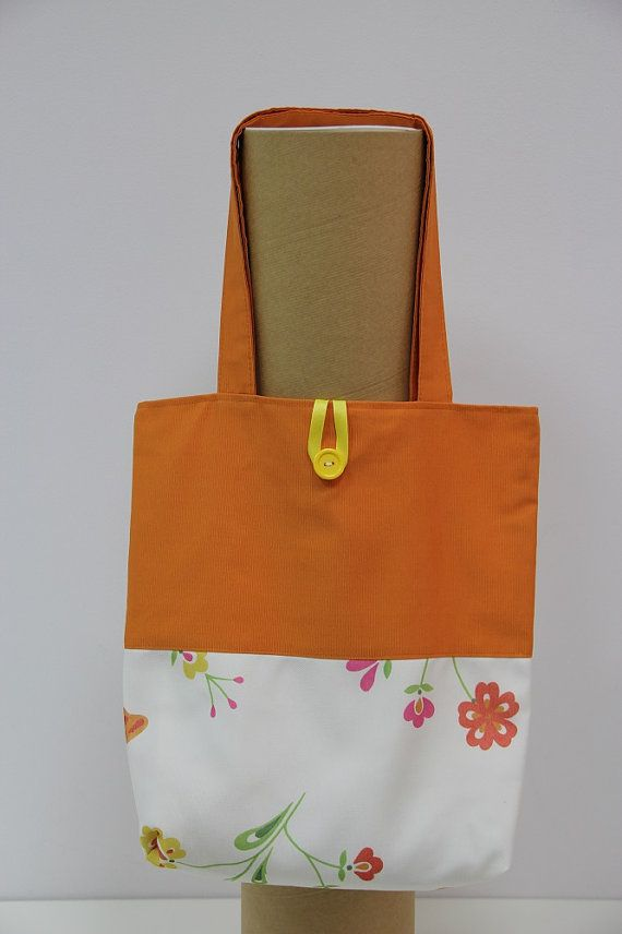This beautiful handmade shopping bag is made from two colors of fabric Its fully lining and has inner pocket. Shopping bag with long handles is
