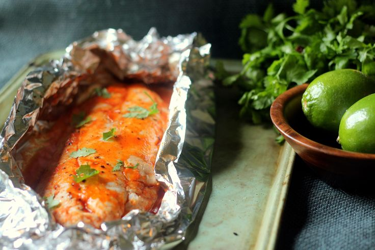 This delicious red snapper recipe is cooked in a foil packet in the oven, basted with a perfect sweet and spicy sriracha based sauce. I serve this with rice..