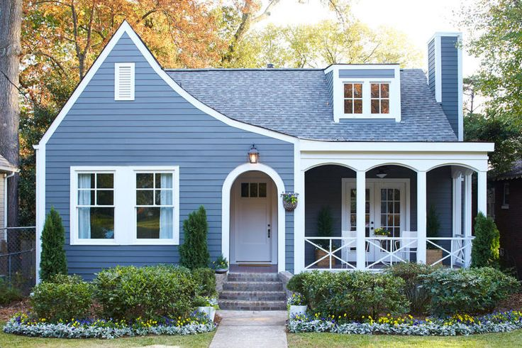 Charmed by a Home - Best Houses of 2016 - Southernliving. This teeny little cottage (our March before and after) was tired until the right architect and team got their hands on it. They painted it gray and added the porch with the arches that emphasize the sloping roofline.