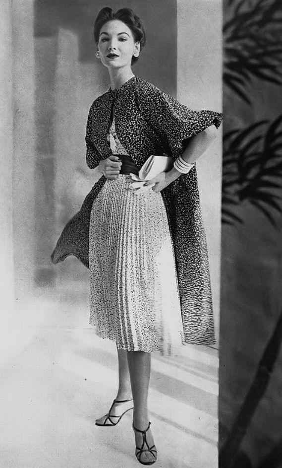 1954 Cherry Nelms in soft silk taffeta dress of white dots on black with coat in reverse print by Balmain