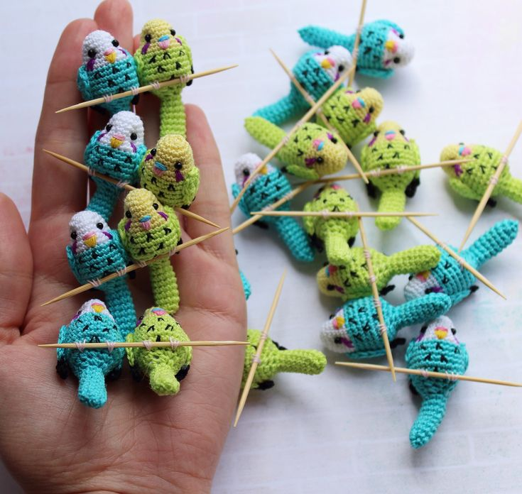 Adorable budgies on sticks by Alena Serebryanska. Explore more of Alena's great work!