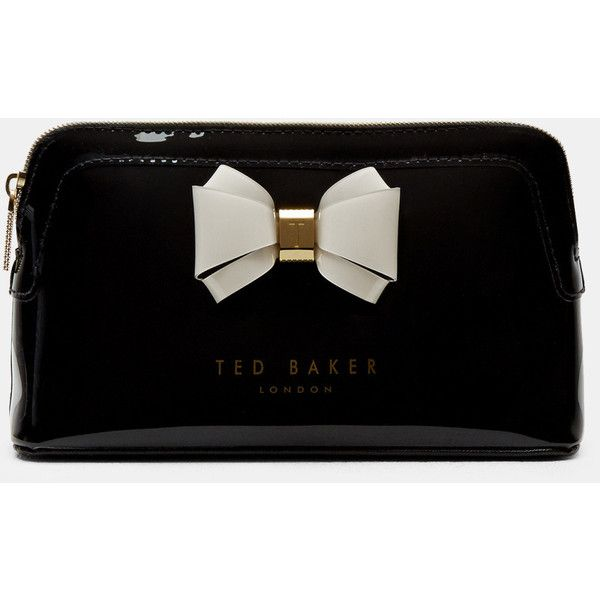 Ted Baker Curved bow small wash bag ($49) ❤ liked on Polyvore featuring beauty products, beauty accessories, bags & cases, black, toiletry kits, makeup bag case, make up bag, make up purse and makeup purse