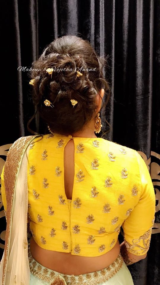 Pretty bridal hairstyle for sangeet. Bridal lehenga. Bridal updo. Hair bun with accessories. Hairstyle by Vejetha for Swank Studio. https://www.facebook.com/pg/MakeupByVejetha/