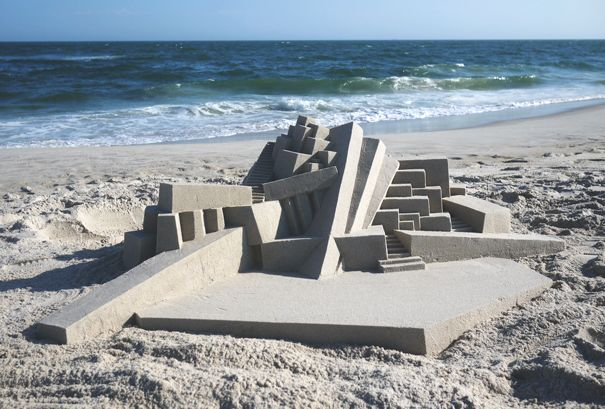 .... What drives one man to spend 10 hours painstakingly building a brutalist      sandcastle?