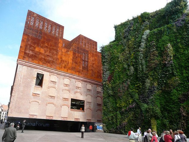 Caixa Forum, Madrid - a museum and cultural center by the Swiss architects Herzog & de Meuron combined an old abandoned electrical station with new construction of floors encased with oxidized cast-iron. The vertical garden, designed by French botanist Patrick Blanc, flourishes with 15,000 plants from 250 species.