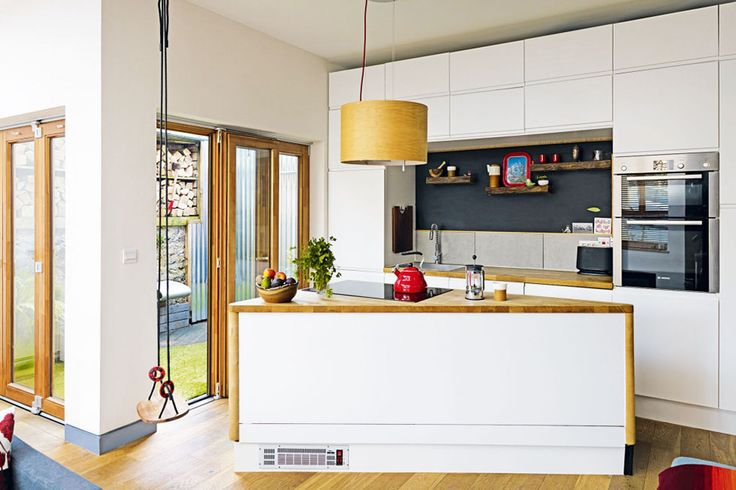 A small but cleverly designed kitchen has units from IKEA, and a triangular island built by the owner with leftover timber from the self build project. View Project →