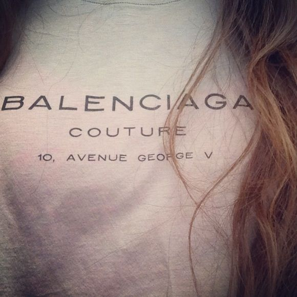 Balenciaga T-shirt top Genuine authentic T-shirt with graphic print. Can be chic under a blazer or casual with jeans, can't go wrong with Balenciaga! Balenciaga Tops Tees - Short Sleeve