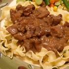 Beef Tips & Noodles  1 pound sirloin tips, cubed  1 (10.75 ounce) can condensed cream of mushroom soup  1 (1.25 ounce) package beef with onion soup mix  1 (4.5 ounce) can mushrooms, drained  1 cup water  1 (16 ounce) package wide egg noodles  400 deg  mix soups mushrooms water & add beef tips in 13x9 dish bake 1 hr  cook pasta serve beef over pasta