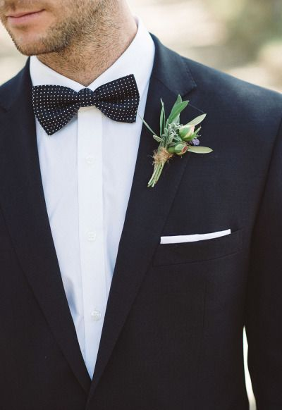 Spotted bow tie, classic black suit #buttonhole #groom