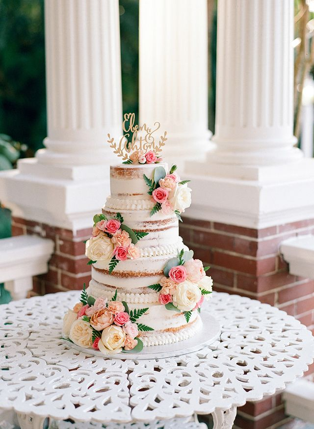 shannon griffin; florida wedding; The Heitman House; three tier cake; naked cake; naked cake decorated with fresh flowers;
