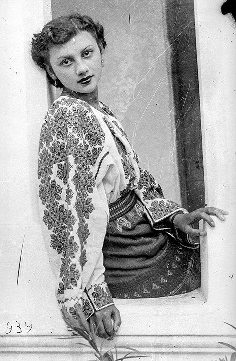 This woman poses in an elaborately patterned blouse, traditional to her Romanian region in 1939