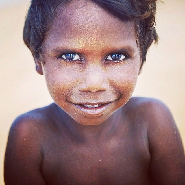 A local indigenous boy out hunting with his dad on Bremer Island, East Arnhem Land.