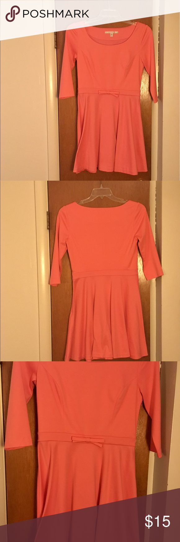 Lauren Conrad Salmon colored dress This dress is such a pretty color! Only worn once, in perfect condition!!! This salmon color would look beautiful with a nice tan and nude heels! Comfortable and has nice stretch! #laurenconrad #salmon #orange #dress #pretty #feminine #perfectcondition #tan #nudeheels #stretchy #comfortable LC Lauren Conrad Dresses Midi