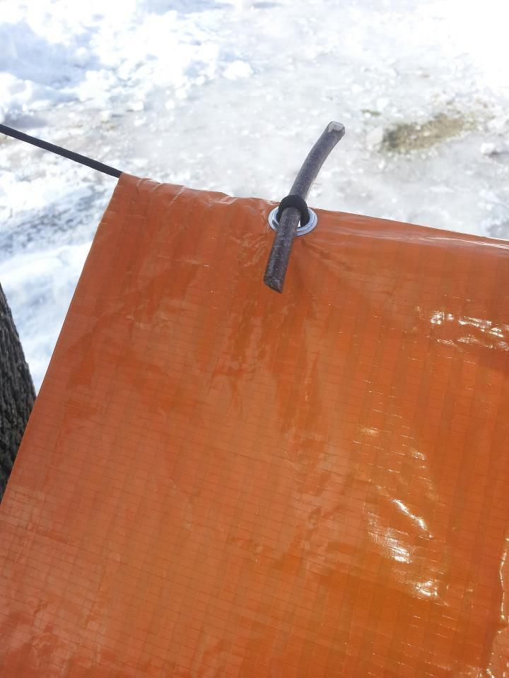 A Tremendous Tarp Trick. Here's a quick tip for setting up a tarp shelter. Pull some of the ridgeline through each grommet and use a small stick to hold the tarp in place