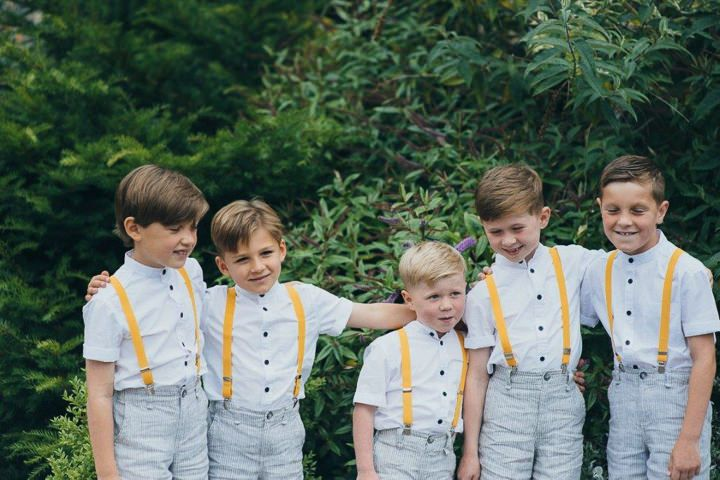 Keeping it classy all the way down to the little ones!  Boys will be boys so don't have to make them wear a full suit, suspenders are just as cute! #greyandyellow #yellowaccents #ringbearer #bridalparty #weddingattire