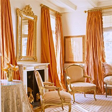 Living Room Beautiful billowy silk curtains the color of an orange