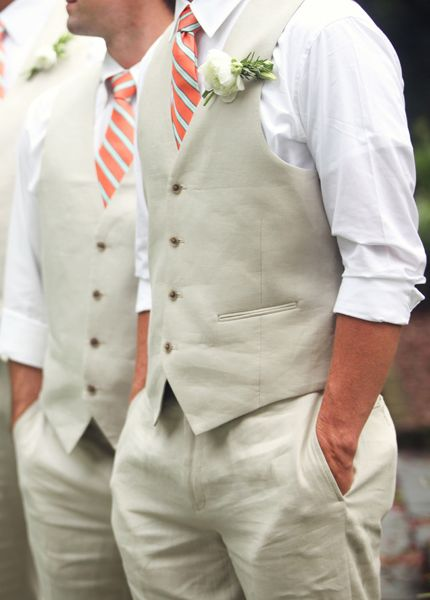 No jackets but rolled up sleeves and vests. I like this idea.  Tan for groomsmen and navy for groom