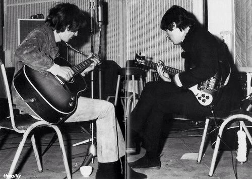 George Harrison and Paul McCartney during the Rubber Soul sessions in 1965