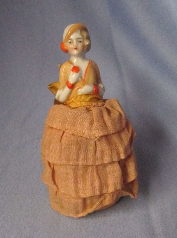 I think this is from the 1930's to 1940's, but I am not sure of that. I am unable to find a mark. Older pin cushion half doll. Condition: Fabric has fading & some soiling. Doll leans to the back. | eBay!