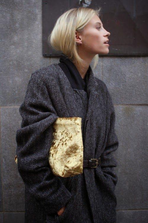 Gray oversized coat and golden velvet clutch