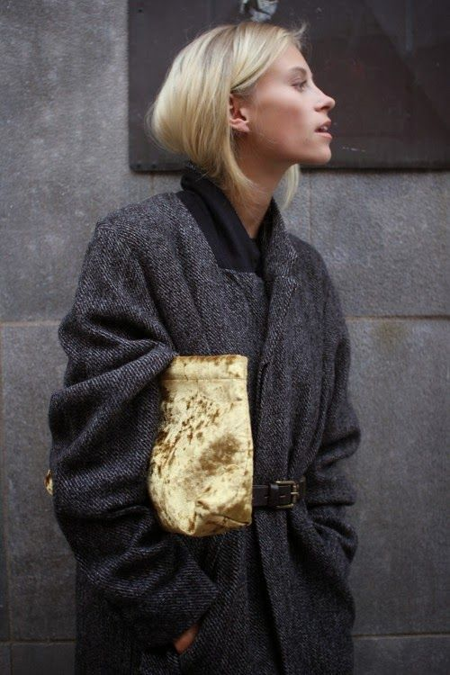 Gray oversized coat and golden velvet clutch