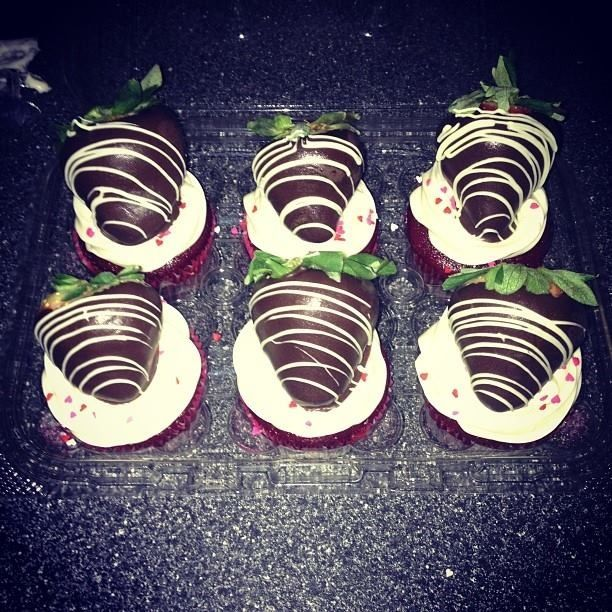 Dipped strawberries on cupcakes