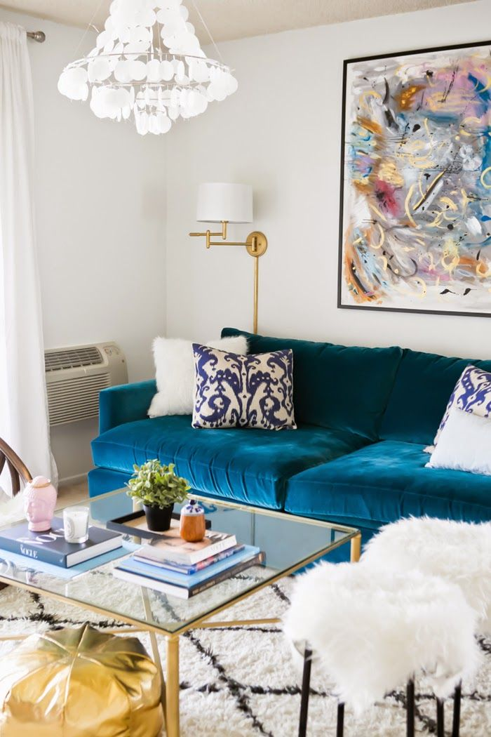 Love All Except Light Blue Velvet Sofa Looks Divine Tour A Small Apartment Brimming With Chic DIY Style Furry Stools Art